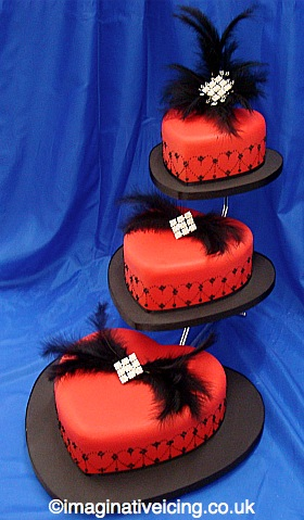 Red Hearts Wedding Cake with Feathers and Diamante Broaches