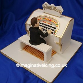 Man playing Wurlitzer Birthday Cake