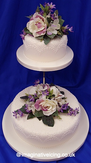 Lace Piping and Silk Flowers Ivory Wedding Cake