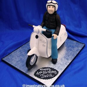 Man riding a Scooter Birthday Cake