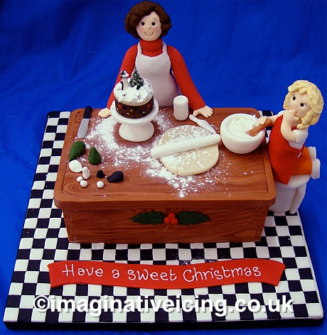 Christmas home baking - Mother & child Making, Baking and Decorating a Christmas cake