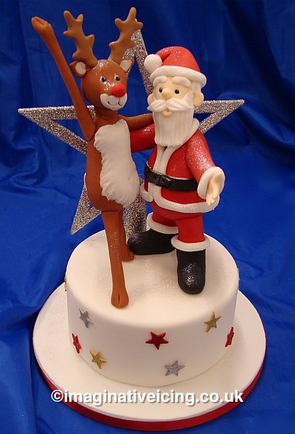 Rudolf the red nosed Reindeer & Father Christmas dancing on a Star covered Christmas cake