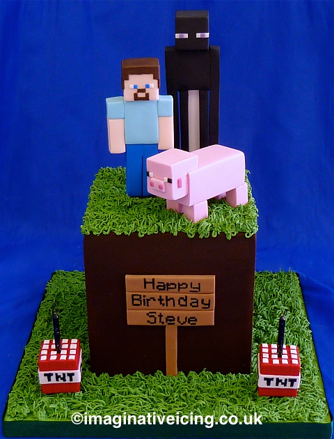 Birthday Cake shaped as a Minecraft grass cube with Enderman, Steve and Pig characters plus some TNT candle holders