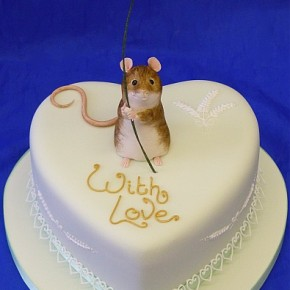 Lovable Field Mouse seeks romance... heart shaped Valentine cake.