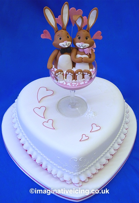Valentines Love Bunnies sat in pink Champagne - Heart Shaped Engagement Cake
