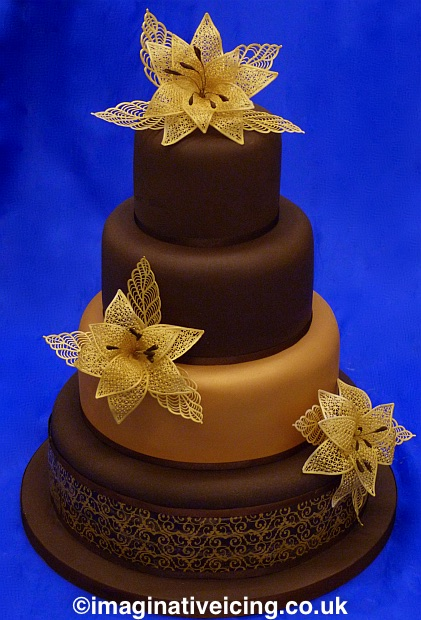 chocolate wedding cake with edible gold lace flowers