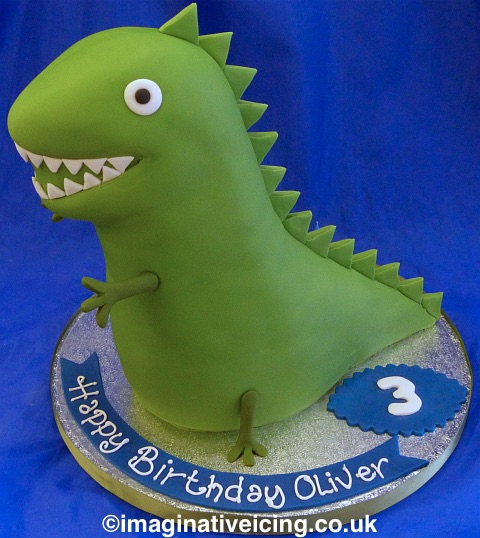 Green toy dinosaur cake